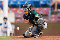 Catcher Eric Fryer #34 of the Lynchburg Hillcats goes down to block a throw at the plate against the Winston-Salem Dash at Wake Forest Baseball Stadium August 30, 2009 in Winston-Salem, North Carolina. (Photo by Brian Westerholt / Four Seam Images)