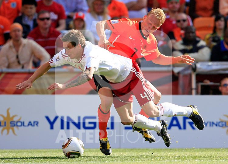 Daniel Agger (4) and Dirk Kuyt Soccer Football - 2010 FIFA World Cup - Group E - Netherlands v Denmark Johannesburg Soccer City Stadium South Africa, Monday, June 14, 2010.