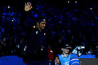 Roger Federer of Switzerland waves to the crowd as he walks onto court at the ATP World Tour Finals, The O2, London, 2015