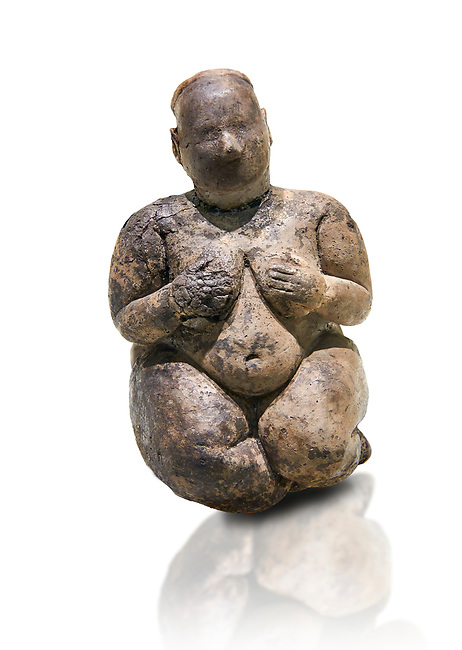 Seated terracotta goddess, probably a sign of fertility. Catalhoyuk Collections. Museum of Anatolian Civilisations, Ankara. Against a white background