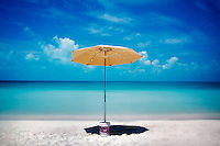 Sappodilla Bay with umbrella. P{rovidenciales, Turks and caicos