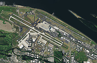 aerial photograph of Portland International Airport (PDX), Portland, Multnomah County, Oregon located along the Columbia River, 2014.  PDX is joint civil-military airport used by the 142 Fighter Wing a unit of the Oregon National Guard  which operates the F15C Eagle. For more recent aerial photographs of PDX contact Aerial Archives directly.