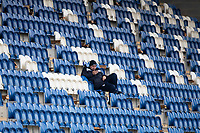 A lone official in the stands at the behind doors fixture between Colchester United vs Oldham Athletic, Sky Bet EFL League 2 Football at the JobServe Community Stadium on 3rd October 2020