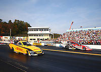 Oct 6, 2013; Mohnton, PA, USA; NHRA funny car driver Del Worsham (left) races alongside Chad Head during the Auto Plus Nationals at Maple Grove Raceway. Mandatory Credit: Mark J. Rebilas-