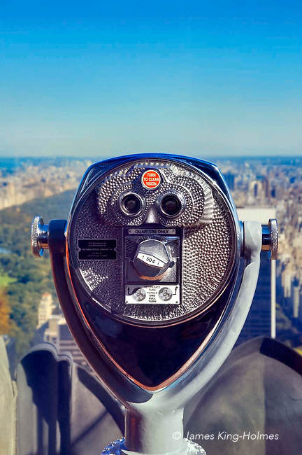 Viewing telescope overlooking Central Park on exterior viewing platform at the top of the Rockefeller Centre, New York