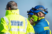 Pictured: Coast guards continue their search near Machynys, Llanelli, Wales, UK. Wednesday 04 November 2020  <br /> Re: Emergency services are searching for missing cockle picker Darren Rees, off the Carmarthenshire coast in Wales, UK.<br /> The 43 year old was last seen on Tuesday afternoon when he was cockling at low tide in the Machynys area of Llanelli.<br /> Dyfed-Powys Police, the coastguard and the national police helicopter are searching the coast and Loughor Estuary for Mr Rees.<br /> He was reported missing at about 18:40, but has not been seen since before it went dark.<br /> Police said he was last seen wearing green waders and a blue jumper, and have asked anyone who may have seen him to contact the force.