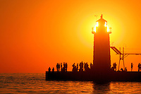People lighthouse sunset silhouette at South Haven Michigan