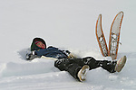 Vuntut Gwitchin First Nation member, Rachael Blake Elias, 13, takes a rest in the snow after snowshoeing near Old Crow, Yukon Territory, Canada.
