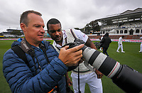 Windies' Shannon Gabriel checks out Getty Images photographer Hagen Hopkins' team photo during day four of the second International Test Cricket match between the New Zealand Black Caps and West Indies at the Basin Reserve in Wellington, New Zealand on Monday, 14 December 2020. Photo: Dave Lintott / lintottphoto.co.nz