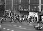 Pittsburgh PA:  Large Civil Rights demonstrations along Liberty Avenue in Pittsburgh August 26th, 1969. The large crowd came from a rally in Point State Park heading for Grant Street.  Brady Stewart Jr took the photograph from Brady Stewart Studio offices; the 2nd floor of the Empire Building (next to the Jenkins Arcade).