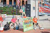 """People gather outside the Massachusetts State House for the No Mandatory Flu Shot MA demonstration in Boston, Massachusetts, on Sun., Aug. 30, 2020. The protest was organized in opposition to a newly-enacted law requiring most children in Massachusetts to receive flu vaccines this year as part of public health efforts during the ongoing Coronavirus (COVID-19) global pandemic. Some of those involved in this protest have been involved in the right-wing pro-Trump, pro-reopening protests organized by Super Happy Fun America during spring and summer 2020. <br /> <br /> The signs here read """"Repeal flu mandate now,"""" """"My body / my choice,"""" and """"Flu shots not mandatory / unsafe our choices."""""""