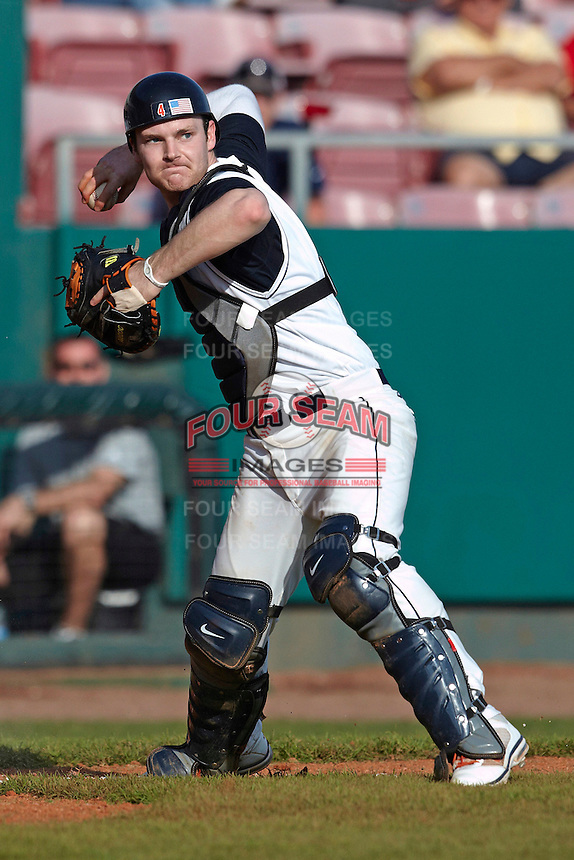 Illinois Fighting Illini catcher Kelly Norris-Jones #4 throws to first during a game against the Louisville Cardinals at the Big Ten/Big East Challenge at Al Lang Stadium on February 18, 2012 in St. Petersburg, Florida.  (Mike Janes/Four Seam Images)