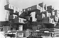 1967 FILE PHOTO - ARCHIVES -<br /> <br /> This may look like the home of ancient cliff dwellers but it's supposed to be the home of the future. Habitat '67 is being built completely on Expo grounds to show a solution for the problems of urban sprawl and lacklustre apartment life.<br /> <br /> 1967<br /> <br /> PHOTO : Boris Spremo - Toronto Star Archives - AQP