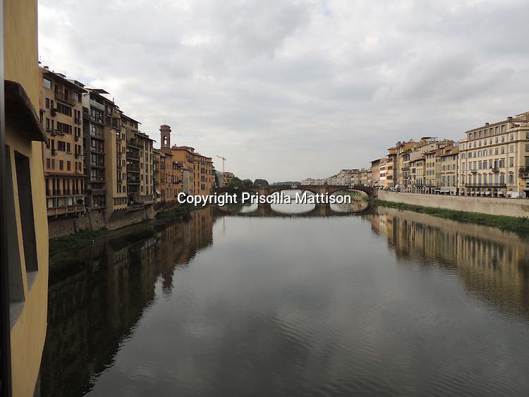 Florence, Italy - October 3, 2012:  The Ponte Santa Trinita spans the Arno River.