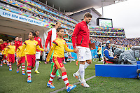 Steven Gerrard of England walks his team out the tunnel