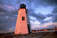 Goat Island Lighthouse glows orange at sunset