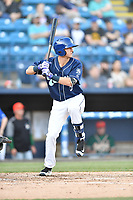 Asheville Tourists second baseman Matt McLaughin (5) swings at a pitch during a game against the Greensboro Grasshoppers  at McCormick Field on May 10, 2018 in Asheville, North Carolina. The Tourists defeated the Grasshoppers 9-3. (Tony Farlow/Four Seam Images)