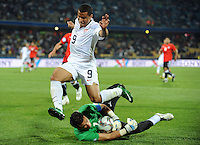 Charlie Davies (9) of USA hurdles the challenge of Essam El Hadary (1) of Egypt. USA defeated Egypt 3-0 during the FIFA Confederations Cup at Royal Bafokeng Stadium in Rustenberg, South Africa on June 21, 2009.