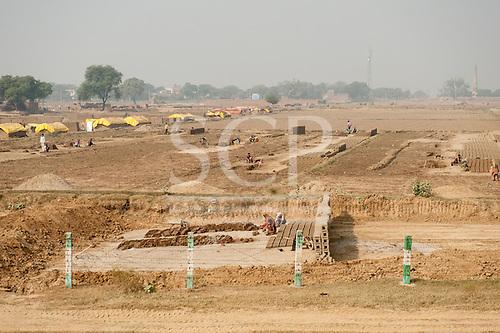 Uttar Pradesh, India. Agra to Delhi. rural brick making in a roadside field.