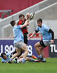 Ben Quinn of Ennis  in action against Derry Gleeson and Aaron Stacey of Garryowen during their U-18 Munster Club Final at Thomond Park. Photograph by John Kelly.