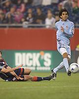 Colorado Rapids midfielder Mehdi Ballouchy (8) shoots as New England Revolution midfielder Wells Thompson (7) defends. The New England Revolution tied the Colorado Rapids, 1-1, at Gillette Stadium on May 16, 2009.