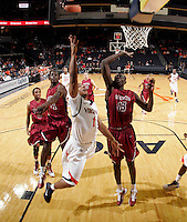 Nov 6, 2010; Charlottesville, VA, USA; Virginia Cavaliers Jontel Evans (1) shoots the ball in front of Roanoke College Papa Fall (43) Saturday afternoon in exhibition action at John Paul Jones Arena. The Virginia men's basketball team recorded an 82-50 victory over Roanoke College.
