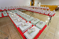 """COPY BY TOM BEDFORD<br /> Pictured: Some of the brides' shoes on display at the John Pye Auctions warehouse in Pyle, south Wales, UK.<br /> Re: A bride cried tears of joy after her missing wedding dress was found among a pile of 20,000 gowns in a warehouse.<br /> Meg Stamp, 27, paid £1,300 for the beautiful ivory lace dress but it  was seized by liquidators after a bridal company went bust.<br /> It was boxed up along with 20,000 others and due to be sold for a knock-down price at auction.<br /> But determined Meg banged on the auctioneer door saying: """"I want my dress back"""".<br /> Staff at John Pye auctioneers in Port Talbot spent three hours sifting through boxes until they finally found Meg's dream dress."""