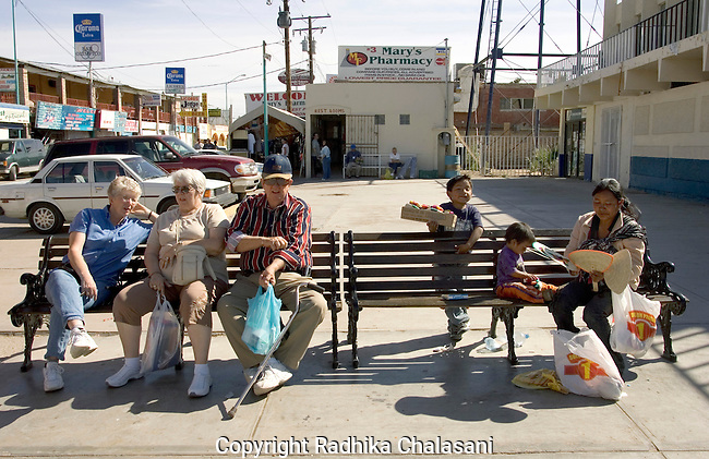 ALGODONES, MEXICO-MARCH 22 : Snowbirds take a break from shopping in the town square March 22, 2005 in Algodones. Most tourists come for day visits and  stay in RV campsites or nearby hotels if they are visiting Algodones for extended proceedures. ©Radhika Chalasani