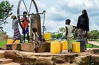 BURKINA FASO, Koumbia, water pump in village / Brunnen mit Drehrad im Dorf