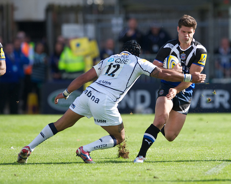 Dan Hipkiss of Bath Rugby is tackled by Sam Tuitupou of Sale Sharks during the Aviva Premiership match between Bath Rugby and Sale Sharks at the Recreation Ground on Saturday 29th September 2012 (Photo by Rob Munro)