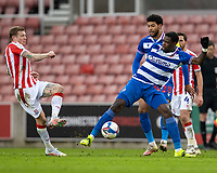 6th February 2021; Bet365 Stadium, Stoke, Staffordshire, England; English Football League Championship Football, Stoke City versus Reading; Lucas Joao of Reading under pressure from James McClean of Stoke City
