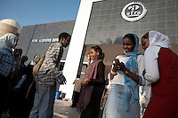 Teenagers meet outside the Afra mall. Khartoum's first mall 'Afra' opened in 2004 and has become popular with affluent Sudanese.