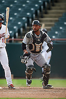 Akron RubberDucks catcher Alex Monsalve (24) checks the runner after blocking a pitch in the dirt with Drew Dosch (11) batting during the second game of a doubleheader against the Bowie Baysox on June 5, 2016 at Prince George's Stadium in Bowie, Maryland.  Bowie defeated Akron 12-7.  (Mike Janes/Four Seam Images)