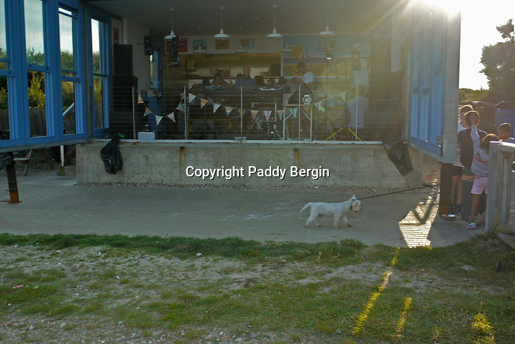 The Reluctant Dog.<br /> <br /> Free Rave Dance Party at West Beach Cafe, West Beach, Littlehampton, West Sussex during July 2017.<br /> <br /> DJs Max Ludford, Steve Cox, Matt Bergin, Andy Moore, Mark Allister, Michael de Courcy & Harvey Bailey provided a mixture of great dance tracks.<br /> <br /> Stock Photo by Paddy Bergin
