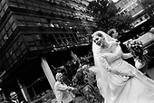 Belgarde, Serbia<br /> October 2000<br /> <br /> A wedding passes by the burnt, state TV station. It was burnt down by protesters successfully forcing President Slobodan Milosevic to admit election defeat.
