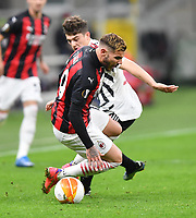 18th March 2021; San Siro stadium, Milan, Italy;  AC Milans Theo Hernandez front challenged by Manchester Uniteds Daniel James during the Europa League round of 16 second leg match between AC Milan and Manchester United in Milan, Italy