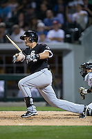 Jason Coats (94) of the Chicago White Sox breaks his bat against the Charlotte Knights at BB&T Ballpark on April 3, 2015 in Charlotte, North Carolina.  The Knights defeated the White Sox 10-2.  (Brian Westerholt/Four Seam Images)