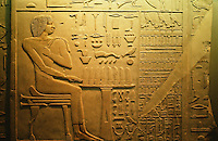 Egypt:  Relief on limestone slab--Tomb of Rahopte, 4th dynasty, about 2550 B.C.  Rahopte seated at a table of offerings. To right, a list of items in tomb equipment.