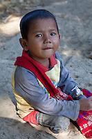 Myanmar, Burma, near Bagan.  Little Burmese Boy in Village.  Burman (Bamar) ethnic group.