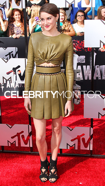 LOS ANGELES, CA, USA - APRIL 13: Actress Shailene Woodley wearing an olive green Balmain two-piece, featuring a ruched bodice and pleated skirt arrives at the 2014 MTV Movie Awards held at Nokia Theatre L.A. Live on April 13, 2014 in Los Angeles, California, United States. (Photo by Xavier Collin/Celebrity Monitor)