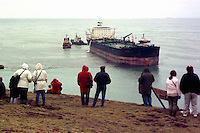 Pictured: Local people look at the Sea Empress which was run aground<br /> Re: The Sea Empress oil spill occurred at the entrance to the Milford Haven Waterway in Pembrokeshire, Wales on 15th February 1996 which was followed up by a clean up operation has begun