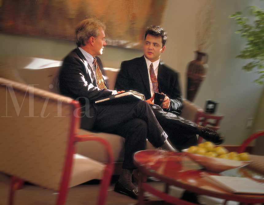 two businessmen having an informal business meeting. Men, talking, conversation, discussion.