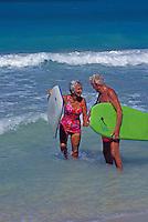 Senior couple enjoying themselves at the beach