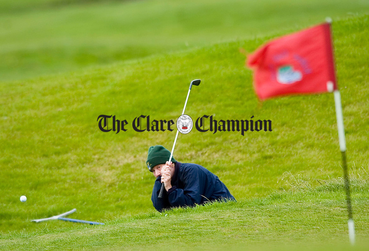 Nuala O Riardon of Limerick plays from a bunker during the Captain's prize for women seniors at Kilkee Golf Club. Photograph by John Kelly.