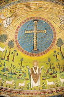 Apse Mosaics with a simple Orthodox crucifix and a depiction of St. Apollinare. 6th century AD Byzantine Roman Mosaics of the Basilica of Sant'Apollinare in Classe, Ravenna Italy. A UNESCO World Heritage Site.