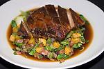 Honey Rum-glazed Pot Roast of Pork & Sauteed Shanghai Bok Choy & Fried Plantains & Enoki Mushrooms.Cuba de Asia Restaurant, New York, New York