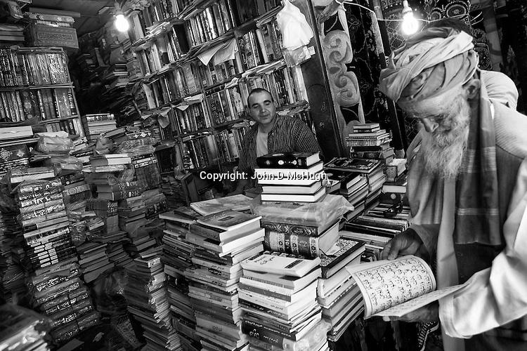 A bookseller is seen at Kabul's ancient bird market, 23 August 2012. (John D McHugh