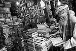 A bookseller is seen at Kabul's ancient bird market, 23 August 2012. (John D McHugh