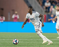 FOXBOROUGH, MA - JUNE 29: Luis Caicedo #27 dribbles at midfield during a game between Houston Dynamo and New England Revolution at Gillette Stadium on June 29, 2019 in Foxborough, Massachusetts.