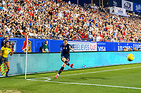 FRISCO, TX - MARCH 11: Megan Rapinoe #15 of the United States takes a corner kick in the first half against Japan during a game between Japan and USWNT at Toyota Stadium on March 11, 2020 in Frisco, Texas.